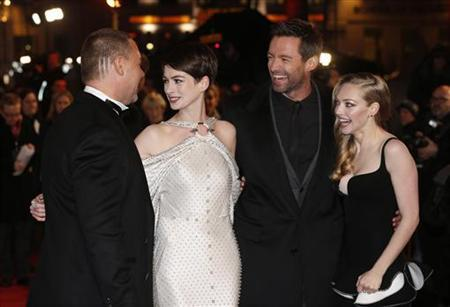 Actors Russell Crowe, Anne Hathaway, Hugh Jackman and Amanda Seyfried (L-R) laugh as they pose for photographers as they arrive for the world premiere of ''Les Miserables'' in London December 5, 2012. REUTERS/Suzanne Plunkett