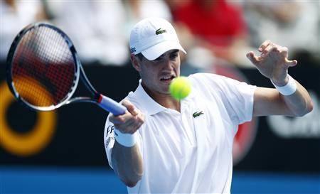John Isner of U.S. hits a return to compatriot Ryan Harrison during their men's singles match at the Sydney International tennis tournament January 9, 2013. REUTERS/Daniel Munoz
