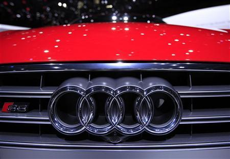 A logo is pictured on an Audi S6 car during the second media day of the 82nd Geneva Auto Show at the Palexpo Arena in Geneva March 7, 2012. REUTERS/Denis Balibouse