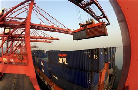 A crane loads containers at a port in Lianyungang, Jiangsu province January 10, 2013. China's export growth rebounded more strongly than expected in December from a three-month low, expanding at the fastest rate in seven months, although the outlook for 2013 remains cloudy with U.S. and European demand for Chinese goods still subdued. REUTERS/China Daily (CHINA - Tags: BUSINESS) CHINA OUT. NO COMMERCIAL OR EDITORIAL SALES IN CHINA