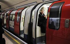 A woman waits for a tube train to depart at an underground station in London January 10, 2013. REUTERS/Luke MacGregor