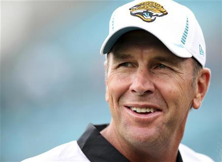 Jacksonville Jaguars head coach Mike Mularkey smiles while on the field during warm-ups their pre-season NFL football game against the New York Giants in Jacksonville, Florida August 10, 2012. REUTERS/Daron Dean