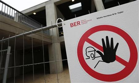 A ''Do not enter the construction site'' sign is pictured at the construction site of the future Berlin Brandenburg international airport Willy Brandt (BER) in Schoenefeld, January 9, 2013. REUTERS/Fabrizio Bensch (GERMANY - Tags: BUSINESS TRANSPORT)
