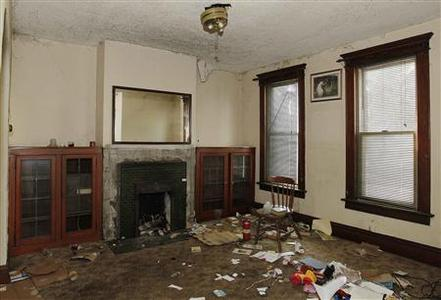 The trashed and damaged living room of Joseph and Jennifer Keller's abandoned house is pictured in Columbus, Ohio, September 30, 2012. REUTERS-Jay LaPrete