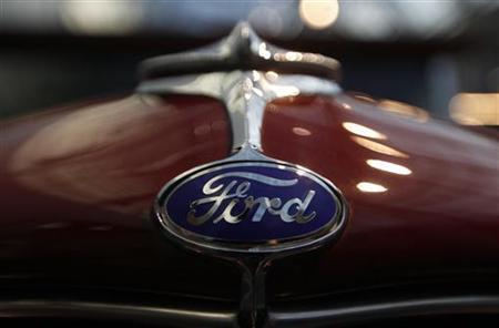 A logo of a Ford car is pictured during a press presentation prior to the Essen Motor Show in Essen November 30, 2012. About 600 exhibitors will present their latest developments at the Essen trade fair from December 1 until December 9, 2012. REUTERS/Ina Fassbender (GERMANY - Tags: TRANSPORT SOCIETY)