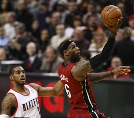 Miami Heat small forward LeBron James (6) drives to the basket against Portland Trail Blazers power forward LaMarcus Aldridge (12) during first quarter of their NBA basketball game in Portland, Oregon, January 10, 2013. REUTERS/Steve Dipaola