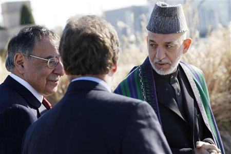 President of Afghanistan Hamid Karzai (R) walks alongside U.S. Defense Secretary Leon Panetta (L) on a guided tour of the Pentagon Memorial, in memory of the victims of the September 11 attack, at the Pentagon in Arlington, Virginia, January 10, 2013. REUTERS/Jonathan Ernst
