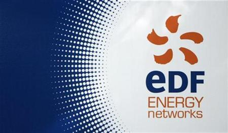 An EDF sign is seen outside an electricity sub-station in North London, in this September 20, 2008 file photograph. REUTERS/Andrew Winning/Files