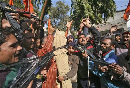Supporters of Shiv Sena, a Hindu hardline group, shout slogans as they hold toy guns and an effigy depicting a Pakistani soldier during a protest in Jammu January 11, 2013. At least four soldiers, two each from India and Pakistan, have been killed in clashes since last Sunday in disputed Kashmir, where the nuclear-armed enemies are separated by a Line of Control (LoC) set up in 1948. REUTERS/Mukesh Gupta