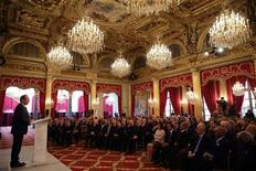 French President Francois Hollande delivers his speech as he attends New Year wishes ceremony for diplomats at the Elysee Palace in Paris, January 11, 2013. REUTERS/Philippe Wojazer (FRANCE - Tags: POLITICS)