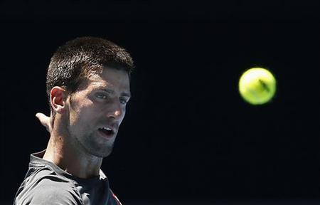 Serbia's Novak Djokovic lines up a shot during a practice session at Melbourne Park January 10, 2013, ahead of the Australian Open tennis tournament which begins on Monday. REUTERS/Tim Wimborne