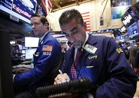 Traders work on the floor of the New York Stock Exchange, January 10, 2013. REUTERS/Brendan McDermid/Files