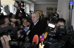 Czech presidential candidate Milos Zeman leaves the polling station as he is surrounded by the media during the country's first ever direct presidential election to replace outgoing president Vaclav Klaus, in Prague January 11, 2013. REUTERS/David W Cerny