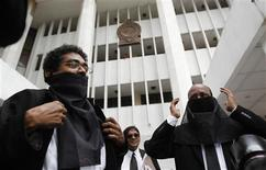 Lawyers wear black cloths across their faces to protest against the impeachment of Chief Justice Shirani Bandaranayke at the Supreme Court's premises in Colombo January 11, 2013. Sri Lankan lawyers boycotted courts on Thursday in protest at government attempts to fire the country's most senior judge, which they branded an attack on judicial independence. The United States, the United Nations and the Commonwealth have also raised concerns that the move to impeach Bandaranayake, on charges including financial irregularities and failure to declare assets, threatens the independence of Sri Lanka's courts. The Supreme Court has declared the impeachment attempt illegal. REUTERS/Dinuka Liyanawatte