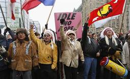 First Nations protesters march towards Parliament Hill before the start of a meeting between chiefs and Canada's Prime Minister Stephen Harper in Ottawa January 11, 2013. REUTERS/Chris Wattie