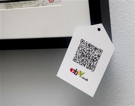 A QR code is seen on goods for sale during the launch of a temporary ''pop-up'' Christmas shop run by online giant eBay on Dean Street in Soho, central London November 29, 2011. REUTERS/Neil Hall/Files