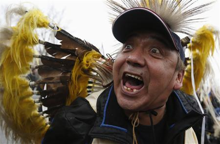 A First Nations protester screams while marching towards Parliament Hill before the start of a meeting between chiefs and Canada's Prime Minister Stephen Harper in Ottawa January 11, 2013. Deep splits emerged in the ranks of Canada's aboriginal movement on Friday, casting doubt on a planned meeting between chiefs and Conservative Prime Minister Harper to discuss a series of native grievances. REUTERS/Chris Wattie