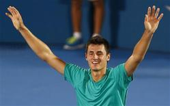 Bernard Tomic of Australia celebrates defeating Kevin Anderson of South Africa during their men's final match at the Sydney International tennis tournament January 12, 2013. REUTERS/Daniel Munoz