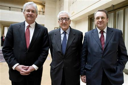 The Joint Special Representative for Syria Lakhdar Brahimi (C) stands with Russian Deputy Foreign Minister Mikhail Bogdanov (R) and United States Deputy Secretary of State William Burns as they meet at the United Nations European headquarters in Geneva January 11, 2013. REUTERS/UN Photo/Jean-Marc Ferre/Handout