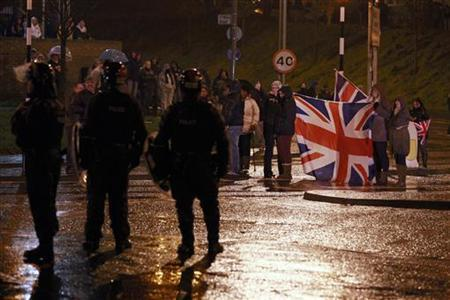Protesters waving a Union flag block the O'Neil road during rioting in South Belfast, January 11, 2013. Violent protests continue in Northern Ireland as loyalists renewed their anger against restrictions on flying the union flag from Belfast City Hall. REUTERS/Cathal McNaughton (NORTHERN IRELAND - Tags: POLITICS CIVIL UNREST)