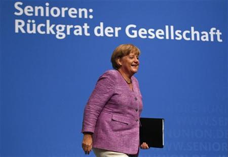 German Chancellor Angela Merkel arrives for a senior delegates meeting of the conservative Christian Democratic Union (CDU) in the western city of Recklinghausen, September 3, 2012. REUTERS/Ina Fassbender (GERMANY - Tags: POLITICS)