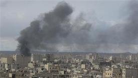 Smoke rises after what activists said was shelling by forces loyal to President Bashar al-Assad at Deir Al-Zor, in this picture provided by Shaam News Network and taken January 9, 2013. REUTERS/Muhammad Younis/Shaam News Network/Handout
