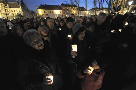Protesters hold candles during anti-austerity and anti-graft protests in Ljubljana January 11, 2013. More than 5,000 Slovenians gathered in the centre of Ljubljana on Friday to protest against a corruption scandal that threatens to bring down the government. Slovenia's anti-corruption commission said earlier this week that Prime Minister Janez Jansa had been unable to explain the source of some of his income in recent years. REUTERS/Srdjan Zivulovic