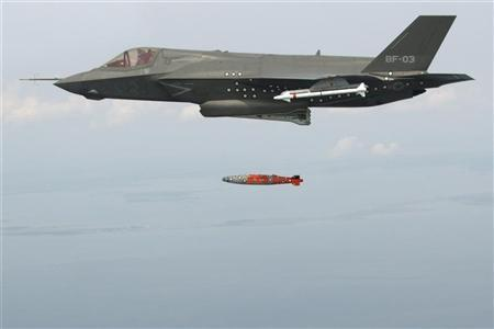 BF-3, a short take-off and vertical landing F-35 Lightning II, releases an inert 1,000 lb. GBU-32 Joint Direct Attack Munition (JDAM) separation weapon over water in an Atlantic test range in Patuxent River, Maryland August 8, 2012. A Lockheed Martin Corp F-35 Joint Strike Fighter aircraft has dropped its first bomb in a new test stage of the Pentagon's costliest weapons purchase, officials said August 9, 2012. REUTERS/Andy Wolfe/Lockheed Martin/Handout
