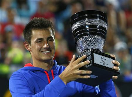 Tomic and Stosur carry Australian hopes in Melbourne
