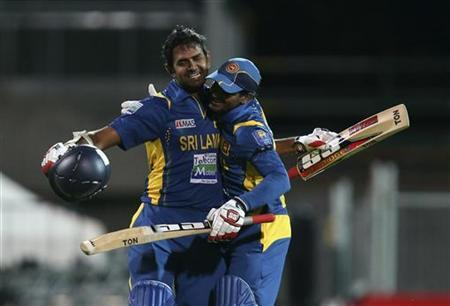 Lahiru Thirimanne (L) of Sri Lanka is congratulated by team mate Kushal Perera for his 100 runs, also the winning run, against Australia during their second one-day international (ODI) cricket series in Adelaide January 13, 2013. REUTERS/Regi Varghese