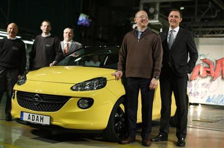General Motors Vice Chairman, interim President of GM Europe and Chairman of the Opel Supervisory Board Steve Girsky (2nd R) and Vice CEO of Opel Thomas Sedran (R) pose in front of an Opel Adam car during the start of the car production in Eisenach January 10, 2013. REUTERS/Lisi Niesner (GERMANY - Tags: BUSINESS TRANSPORT)