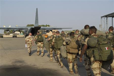 French troops prepare to board a transport plane in N'Djamena, Chad, in this photo released by the French Army Communications Audiovisual office (ECPAD) on January 12, 2013. REUTERS/ECPAD/Adj. Nicolas Richard/Handout