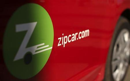 A logo is shown on the side of a Zipcar in San Francisco, California January 2, 2013. REUTERS/Robert Galbraith