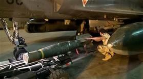 A still image from video released by the French Army Communications Audiovisual office (ECPAD) on January 12, 2013 shows French fitting rockets to a plane in Ndjamena. REUTERS/ECPAD via Reuters Tv/Handout