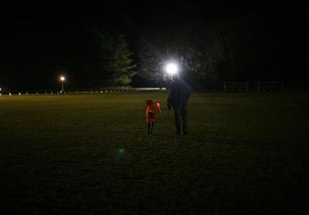 People take part in a candlelight vigil in Newtown, Connecticut, December 21, 2012. REUTERS/Eric Thayer