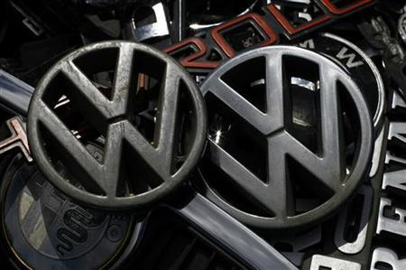 Old Volkswagen emblems are displayed with other car companies logos at antique market in Olszyny near Szczytno, northern Poland July 22, 2012. REUTERS/Kacper Pempel (POLAND - Tags: TRANSPORT BUSINESS LOGO)