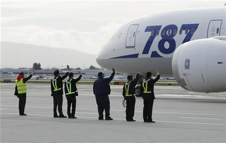 Grounds crew wave at an All Nippon Airways Boeing 787 Dreamliner as it departs San Jose International Airport for Tokyo in San Jose, California January 11, 2013. REUTERS/Robert Galbraith