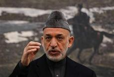 Afghan President Hamid Karzai speaks during a news conference in Kabul January 14, 2013. A decision on immunity for U.S. troops staying in Afghanistan after the 2014 planned withdrawal will be made by the end of the year, Karzai said on Monday. REUTERS/Omar Sobhani