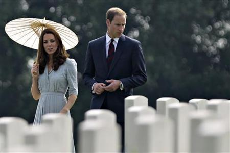 Britain's Prince William (R) and Catherine, the Duchess of Cambridge, visit the Kranji Commonwealth War Cemetery in Singapore September 13, 2012. REUTERS/Tim Chong/Files