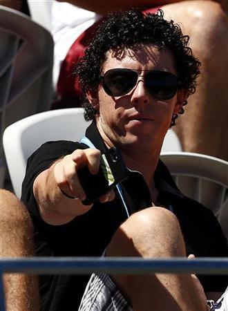 Irish golfer Rory McIlroy, currently ranked world number one, watches Denmark's Caroline Wozniacki during her first round match against Poland's Urszula Radwanska at the Sydney International tennis tournament January 6, 2013. REUTERS/David Gray