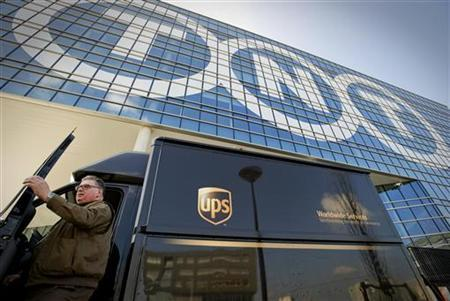 A courier van of UPS is seen in front of the head office of TNT in Hoofddorp, the Netherlands March 19, 2012. REUTERS/Robin van Lonkhuijsen/United Photos (NETHERLANDS - Tags: BUSINESS SOCIETY TRANSPORT)