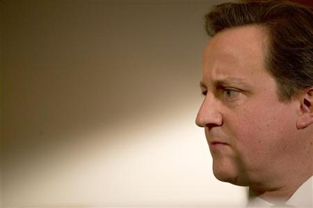 Britain's Prime Minister, David Cameron, listens to Deputy Prime Minister, Nick Clegg (UNSEEN), at a news conference in 10 Downing Street in central London January 7, 2013. REUTERS/Alastair Grant/Pool