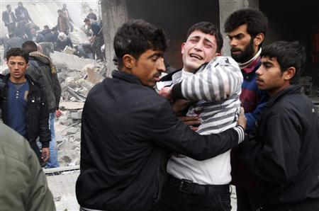 A man mourns the death of his relative killed by what activists said was missiles fired by a Syrian Air Force fighter jet from forces loyal to Syria's President Bashar al-Assad, at the souk of Azaz, north of Aleppo, January 13, 2013. REUTERS/Zain Karam