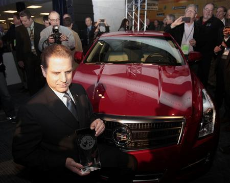 Dave Leone, Chief Engineer for Cadillac, poses with an ATS after it won the ''North American Car of the Year'' award at the North American International Auto Show in Detroit, Michigan, January 14, 2013. REUTERS/Rebecca Cook