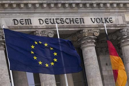 The EU flag and the German national flag fly outside the Reichstag, the seat of Germany's lower house of parliament, the Bundestag, in Berlin November 29, 2012. REUTERS/Thomas Peter