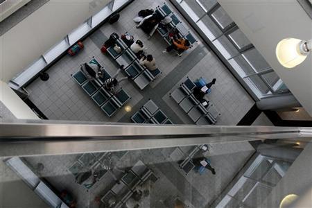 People wait at Ferenc Liszt International Airport in Budapest, February 3, 2012. REUTERS/Bernadett Szabo