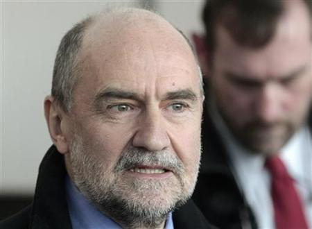 Herman Nackaerts, head of a delegation of the International Atomic Energy Agency (IAEA), speaks to media at the airport in Vienna on his way to Iran December 12, 2012. REUTERS/Herwig Prammer