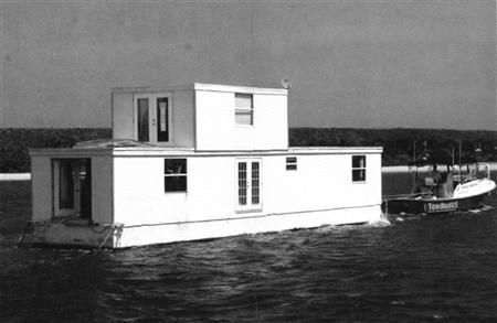 Fane Lozman's houseboat is seen Riviera Beach, Florida, in this undated handout photo taken from court documents. When is a floating home not a vessel? In a ruling on Tuesday, the U.S. Supreme Court told a Florida city its argument did not hold water, and that an abode on water was nothing but a home. In a 7-2 decision, the court ruled that a gray, two-story home which its owner said was permanently moored to a marina in Riviera Beach, Florida, was not a vessel, depriving the city of power under U.S. maritime law to seize and ultimately destroy it. REUTERS/Handout
