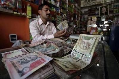 Rupee extends losses; oil demand hurts