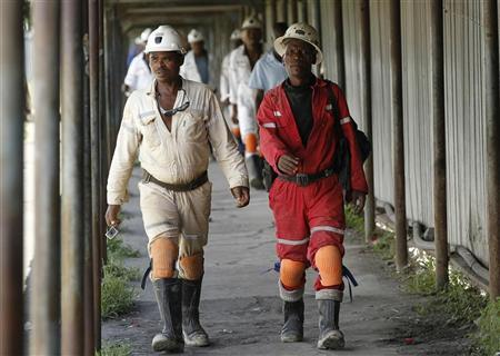Miners walk at the end of their shift at the Anglo Platinum's Khuseleka shaft 1 mine in Rustenburg, northwest of Johannesburg, January 15, 2013. REUTERS/Siphiwe Sibeko